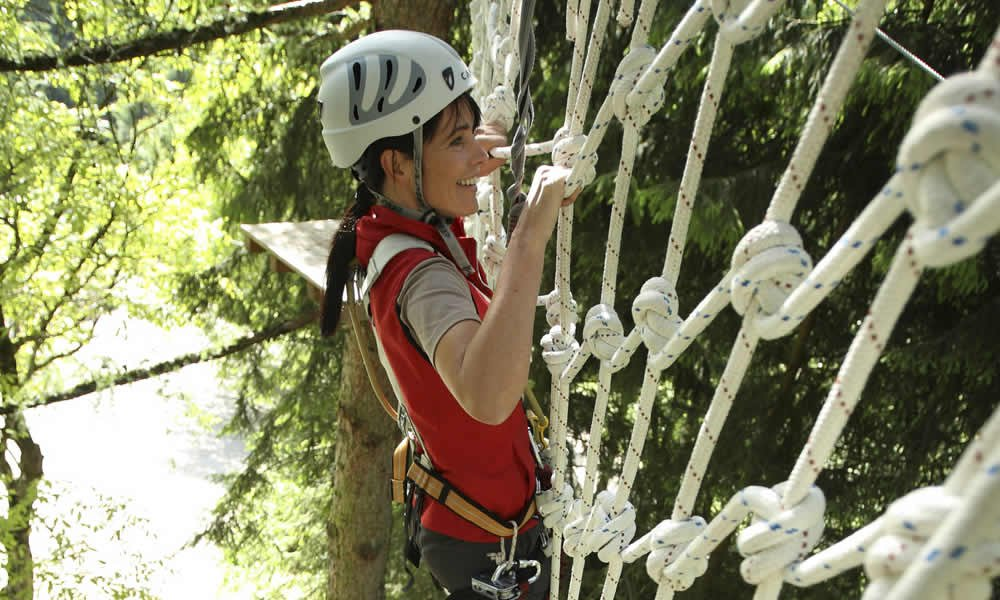 A climbing tour at the high rope course during your hiking holiday in the Dolomites